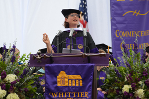 Honorary Poet Sonia Nazario speaks to graduates from the stage at Commencement.