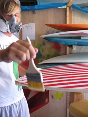 Jung works on his self-made surfboard
