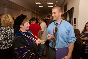 Professor Sharon Herzberger and student share their award medals.