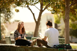 Students engage in conversation in lower quad.