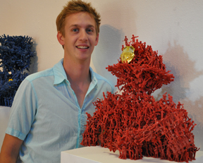 Jeff Edwards '10 stands by his sculpture which recieved 1st place at the greenleaf gallery